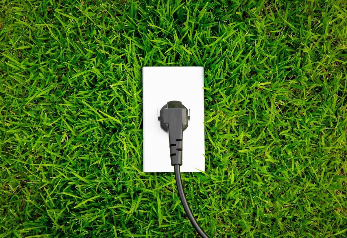 Energy concept outlet fresh spring green grass